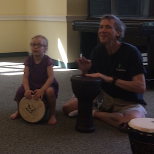 Kids and Parents play drums in Rhythm Kids.